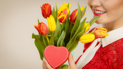 Woman holding tulips and gift