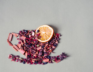 Mulled wine spice ingredients. Image of a cup and saucer from ingredients for mulled wine.