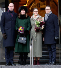 Britain's Prince William, Catherine, Duchess of Cambridge and Sweden's Prince Daniel and Crown Princess Victoria walk from the Royal Palace to the Nobel Museum in Stockholm