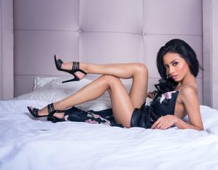 Beautiful woman lying on bed.
