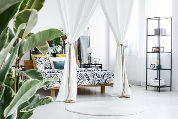 White bedroom interior with drapes