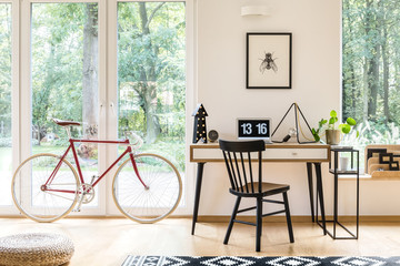 Workspace with red bicycle