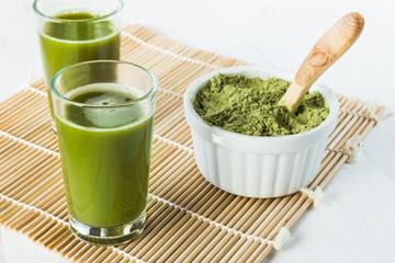 Wheatgrass juice shots in small glasses