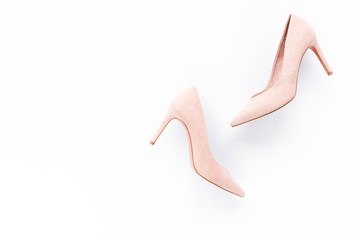 Wall Mural - Pale pink female shoes on white background. Flat lay, top view trendy fashion feminine background. Beauty blog concept.