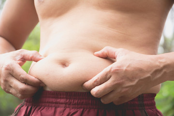 Fat belly man. The Dangers of Belly Fat. Man at risk for diabetes.