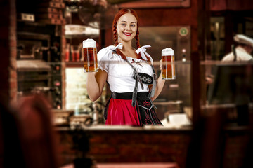 Young slim woman in bavarian clothes and her small business of bar