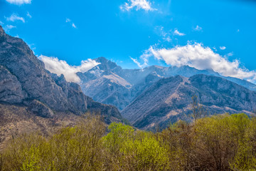 scenic of spring day with mountain landscape shot of Caucasus, travel background