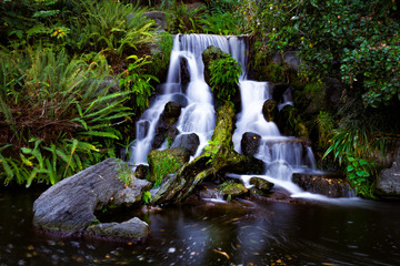 Long exposure shot of a cascading tropical waterfall.