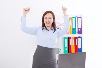 Happy and successful businesswoman raising her arms at office background and celebrating success isolated on white. mock up and copy space. Business concept