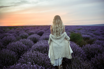Young woman in white dress on the lavender field