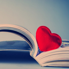 pages of an open book and heart.