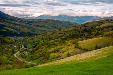village in the valley on a cloudy day. lovely springtime landscape in mountains