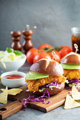 Chicken tender sandwich with avocado and slaw