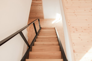 Fototapeten Treppe Metal staircase with wooden treads