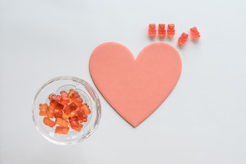 Pink Gummy Bears, Champagne Glass, Heart Shape on White Background
