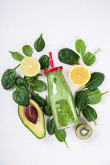 Smoothies Green. Drink Cocktail Spinach,Apple,Kiwi,Lemon,lime,avocado.Food or Healthy diet concept.Vegetarian.Copy space for Text. selective focus.