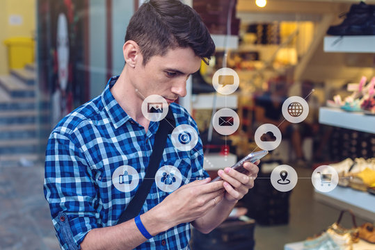 Man uses a smartphone to access social digital media in the Internet. Concept of a global network expansion