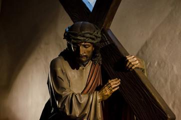 The statue of Jesus bears the cross