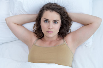 Concerned Caucasian Woman Lying in Bed