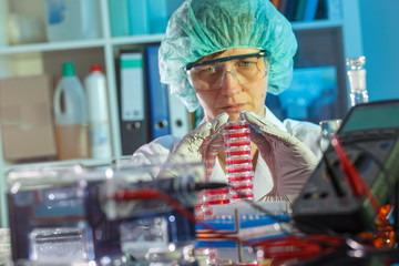 female technician in laboratory research of cancer diseases