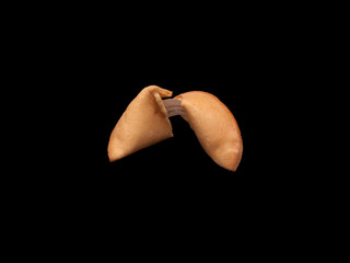A fortune cookie on black background