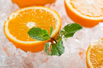 Wall Mural - Juicy oranges on ice cubes.