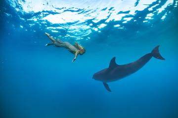 little blonde girl in sea water underwater