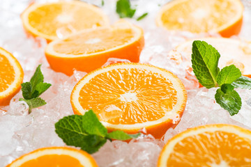 Wall Mural - Segments of orange fruits and ice.