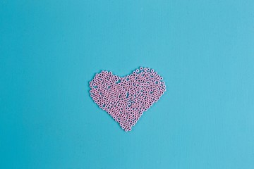 Pink heart of beads, copy space. Love, Valentine, greeting concept