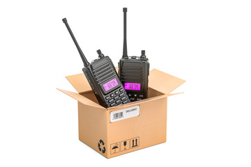 Portable radios walkie-talkie inside cardboard box, delivery concept. 3D rendering