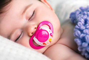 Sleeping Baby with a Pacifier in his Mouth