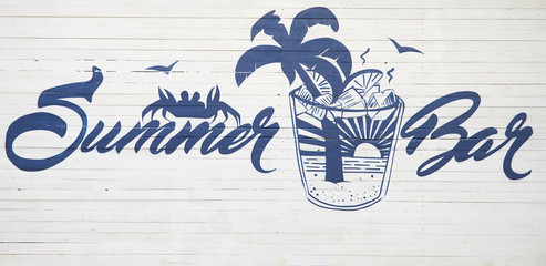 "The inscription ""Summer Bar"" on the fence. Blue inscription in a beautiful font. The atmosphere of summer, relaxation, rest. Place for parties and alcohol."