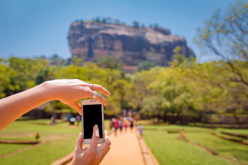 Woman taking a picture of Sigiriya - Lion Rock, Sri Lanka