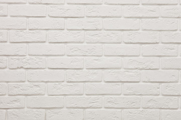 textured wall of white brick. Background. Texture. Design