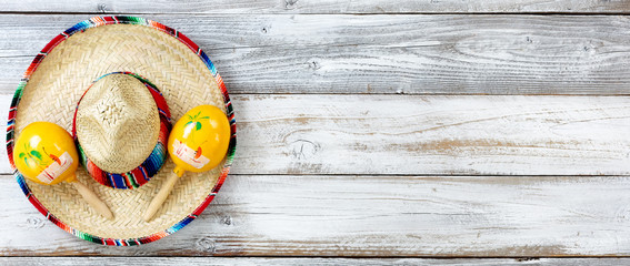 Flat lay view of traditional Cinco De Mayo objects on white weathered wooden boards