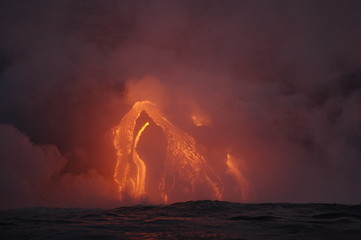 The hot lava of the Hawaiian volcano Kilauea flows into the waters of the Pacific Ocean