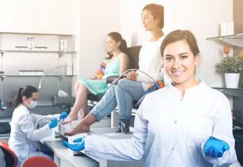 Portrait of professional nail master at working place inviting to salon