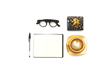 Flat lay with gold coffee cup, glasses and notebook. Blogger mock up