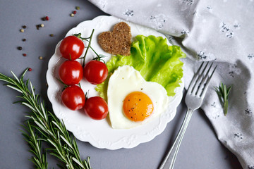 Tasty Fried Egg in the Shape of a Heart Served on a White Plate Rosemary Tomato Salad Leaves Grey Background Valentine Day Morning