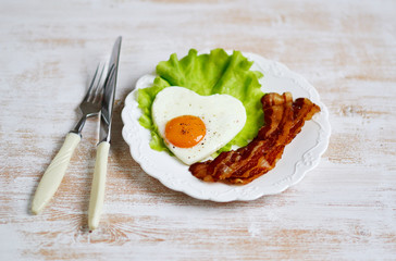 Tasty Fried Egg in the Shape of a Heart Served on a White Plate Bacon Pepper Tomato Salad Leaves Wooden Background Valentine Day Morning