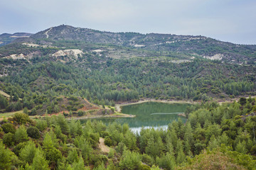 Palaichori dam among the pines in Troodos mountains, Nicosia District, Cyprus.