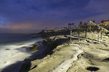 Windansea Beach Pacific Ocean Landscape Scenic Night View with Landmark Palm Covered Shack in La Jolla north of San Diego California