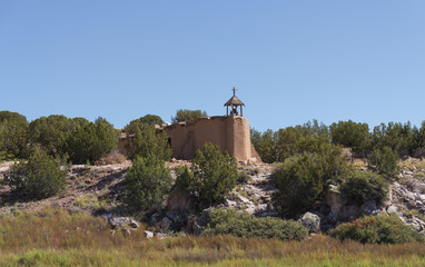 Old Mission Adobe Church Set on Rocky Outcropping against Southwest Landscape