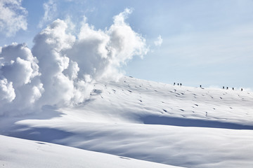 Snowboarders hiking an active volcano in Japan