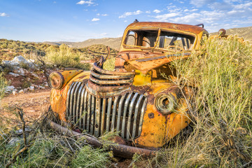 old rusty towing truck at Colorado foothills