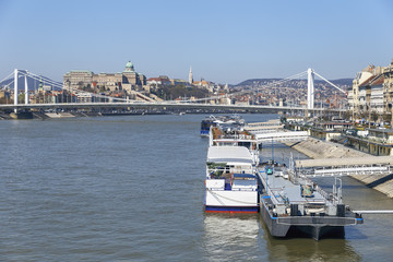 cruise ships at the pier on the Danube, in the background of the historical part of the city