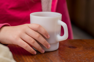 Child drinking out of a mug