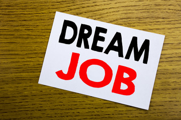 Dream Job. Business concept for Dreaming about Employment Job Position written on sticky note, wooden wood background with copy space.