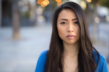Young Asian woman serious face
