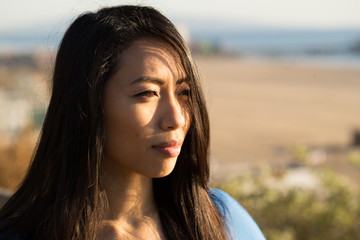 Young Asian woman looking far away